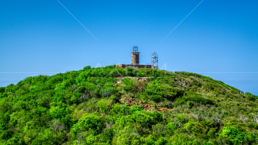 The hilltop Culebrita Lighthouse in Puerto Rico  Aerial Stock Photo AX102_177.0000274F | Axiom Images