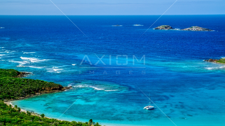 Tiny islands in sapphire blue waters near the coast, Culebrita, Puerto Rico  Aerial Stock Photos | AX102_179.0000000F