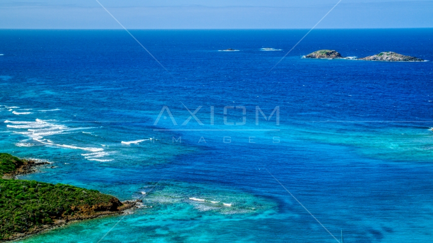 Tiny islands in sapphire blue ocean in the Caribbean, Culebrita, Puerto Rico  Aerial Stock Photos | AX102_179.0000133F
