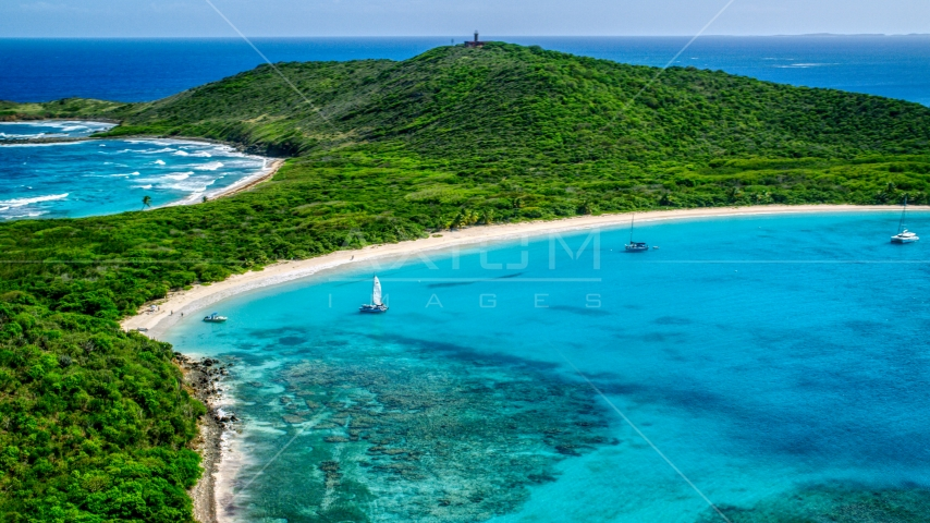 Catamarans in turquoise blue waters beside a white sand Caribbean beach, Culebrita, Puerto Rico  Aerial Stock Photo AX102_182.0000000F | Axiom Images