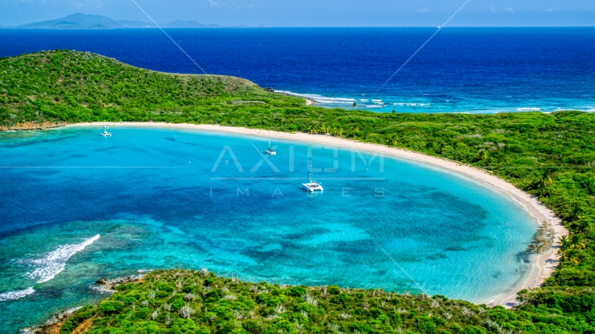 Catamarans in turquoise waters beside a white sand Caribbean beach, Culebrita, Puerto Rico Aerial Stock Photo AX102_184.0000156F | Axiom Images