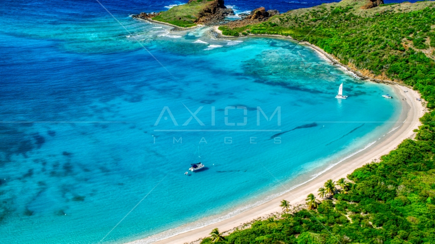 Catamarans beside a Caribbean island beach in Culebrita, Puerto Rico Aerial Stock Photos | AX102_187.0000000F
