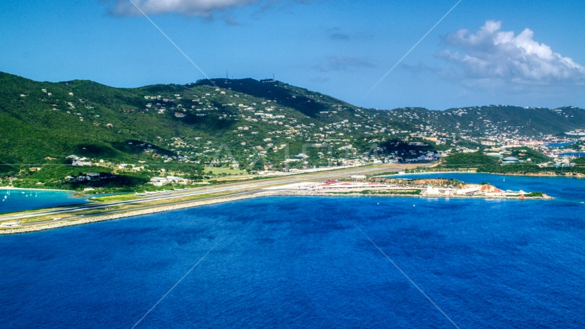 Cyril E King Airport and hillside homes on the coast, St. Thomas, US Virgin Islands Aerial Stock Photo AX102_195.0000000F | Axiom Images