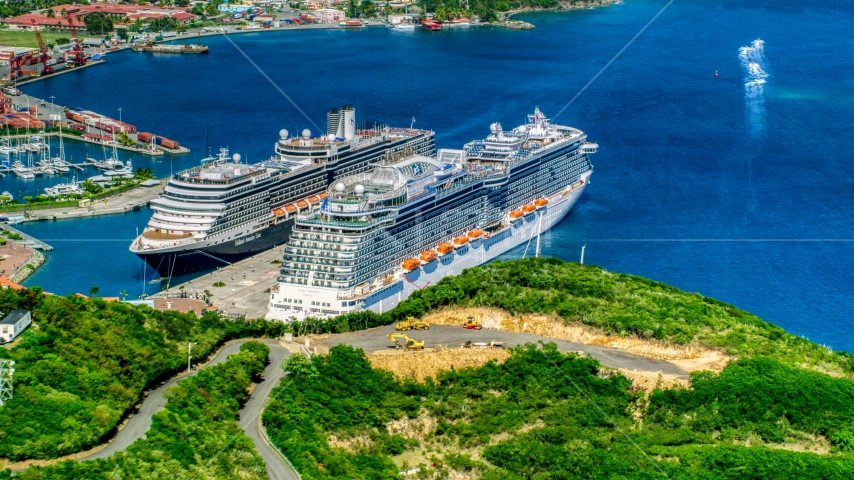 Docked cruise ships in the coastal town pf Charlotte Amalie, St. Thomas, US Virgin Islands Aerial Stock Photos | AX102_199.0000000F