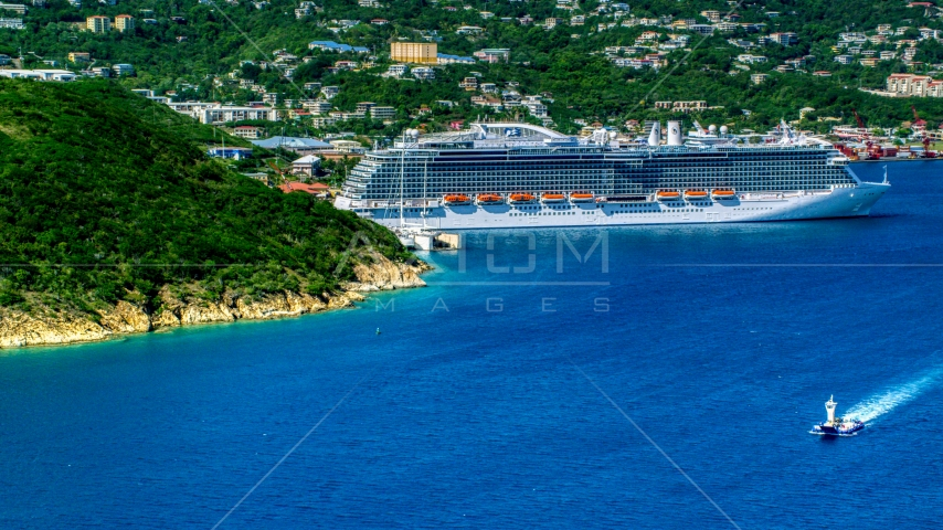 Cruise ship docked at the coastal island town of Charlotte Amalie, St. Thomas  Aerial Stock Photos | AX102_200.0000000F