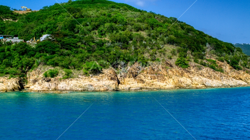 A tropical island coast in sapphire waters, Charlotte Amalie, St. Thomas Aerial Stock Photos | AX102_201.0000234F