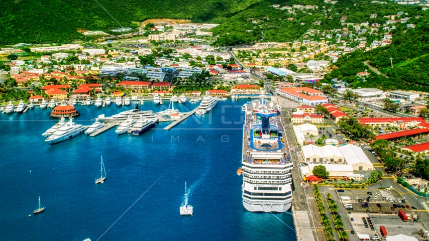 Cruise ship and yachts docked in sapphire waters at a Caribbean island town, Charlotte Amalie, St. Thomas  Aerial Stock Photos | AX102_210.0000000F