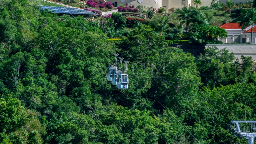 Gondolas above trees near hillside homes, Charlotte Amalie, St. Thomas, US Virgin Islands  Aerial Stock Photos | AX102_211.0000226F