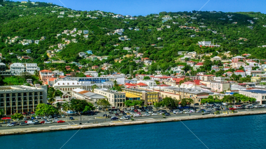 Buildings on the harbor shore in the Caribbean island to of Charlotte Amalie, St Thomas, US Virgin Islands  Aerial Stock Photos | AX102_228.0000000F