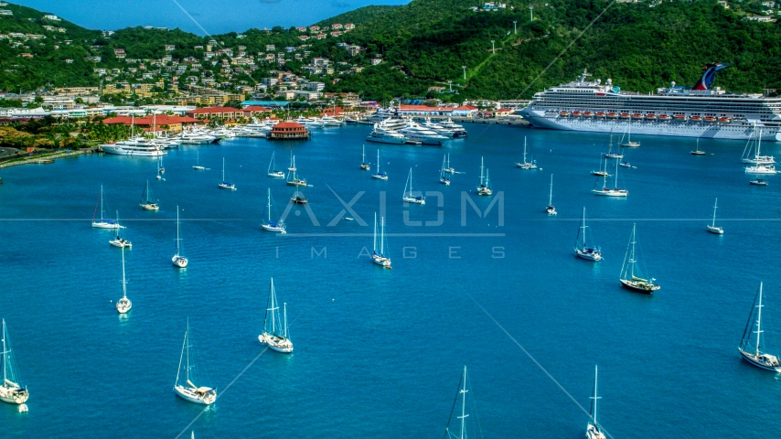 Sailboats and cruise ship in sapphire blue waters of the harbor in Charlotte Amalie, St Thomas Aerial Stock Photos | AX102_230.0000000F