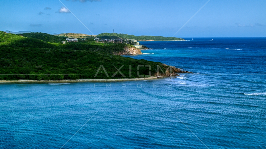 Oceanfront condominiums overlooking sapphire blue waters, Southside, St Thomas  Aerial Stock Photos | AX102_235.0000000F