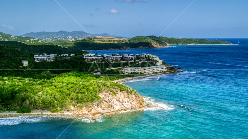 Oceanfront condominiums overlooking sapphire blue waters, Southside, St Thomas  Aerial Stock Photos | AX102_236.0000000F