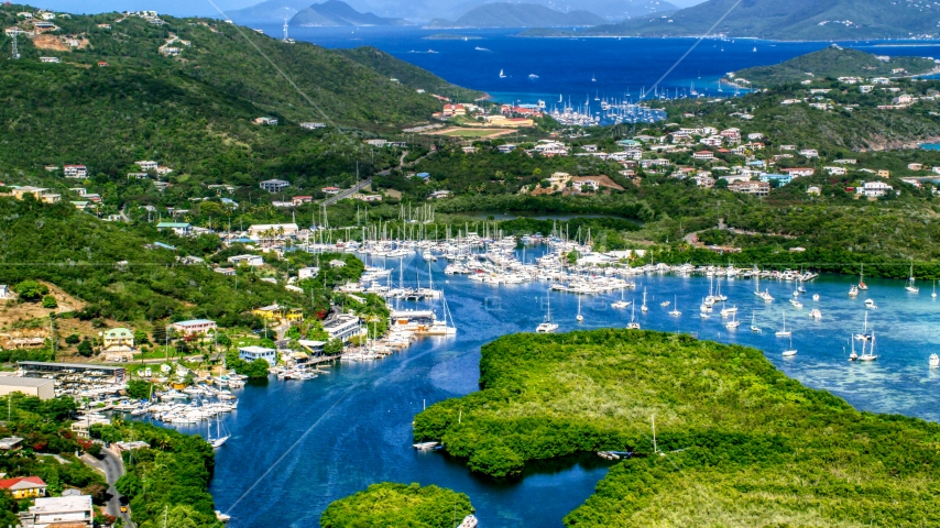 Boats docked at a marina in Benner Bay, St Thomas, US Virgin Islands  Aerial Stock Photos | AX102_238.0000000F