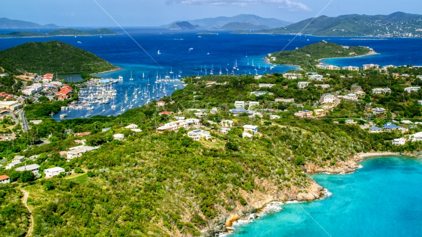 Boats and marina in Vessup Bay in Red Hook near island homes, St Thomas, the US Virgin Islands  Aerial Stock Photos | AX102_241.0000000F