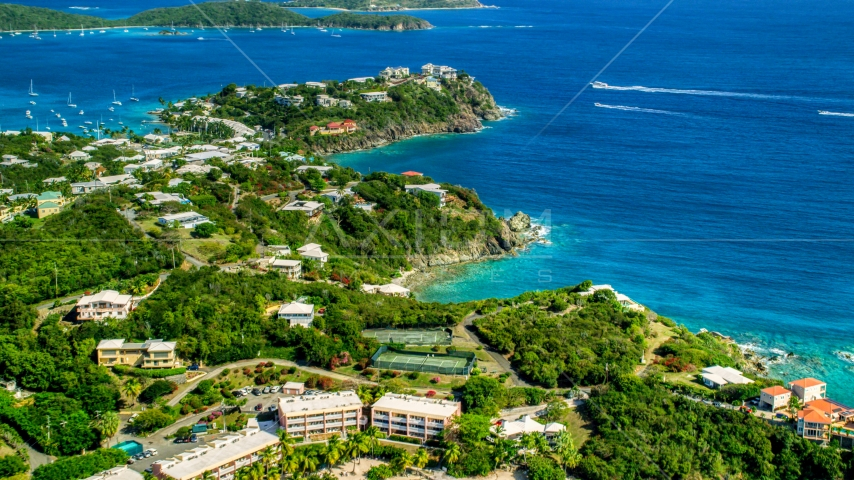 Upscale oceanfront homes beside sapphire blue waters, East End, St Thomas  Aerial Stock Photos | AX102_246.0000000F