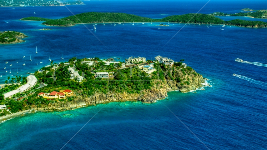 Hillside oceanfront homes overlooking sapphire blue waters, East End, St Thomas  Aerial Stock Photos | AX102_247.0000000F