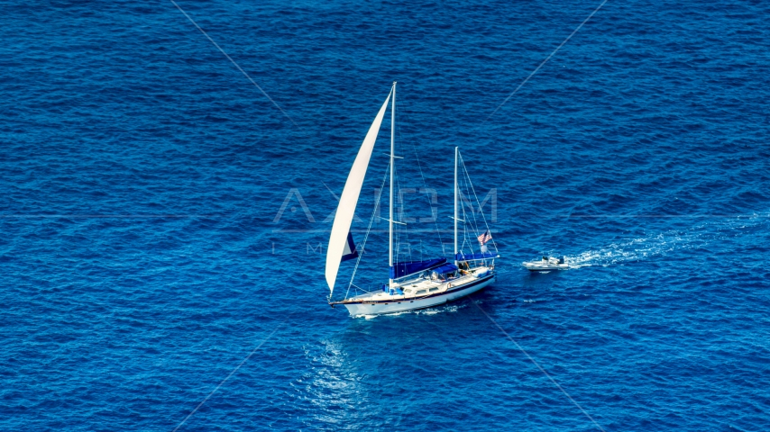 Sailboat in sapphire blue waters, St Thomas, USVI  Aerial Stock Photo AX102_255.0000094F | Axiom Images