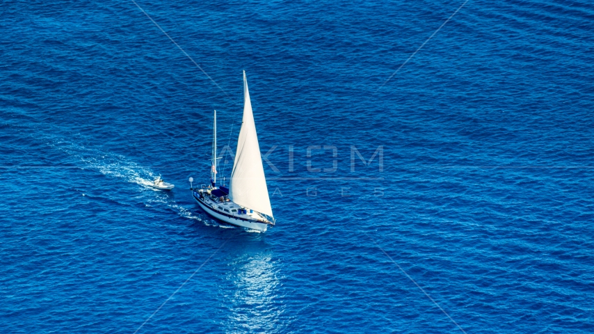 Sailboat in sapphire blue Caribbean waters, St Thomas, USVI  Aerial Stock Photo AX102_256.0000138F | Axiom Images