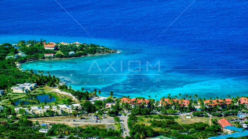 Condominium resort beside sapphire blue Caribbean waters, East End, St Thomas Aerial Stock Photos | AX102_257.0000099F