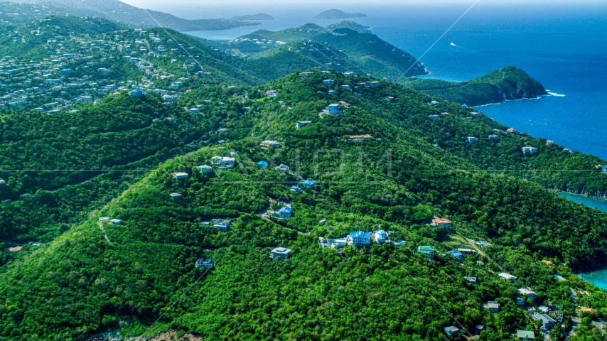 Hilltop island homes over looking the blue ocean waters by the coast, East End, St Thomas  Aerial Stock Photos | AX102_259.0000000F