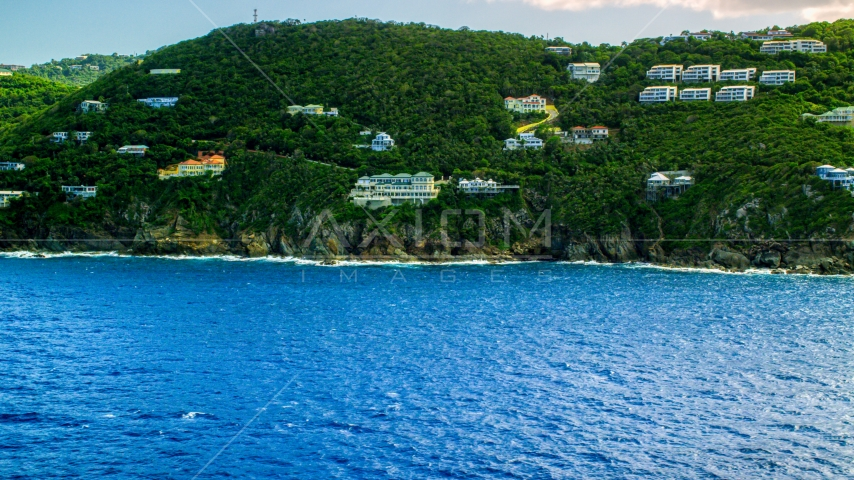 Hillside oceanfront island homes by sapphire waters, Northside, St Thomas Aerial Stock Photo AX102_262.0000000F | Axiom Images