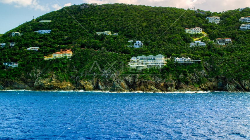 Hillside oceanfront mansions on a Caribbean island, Northside, St Thomas, the US Virgin Islands  Aerial Stock Photos | AX102_262.0000315F