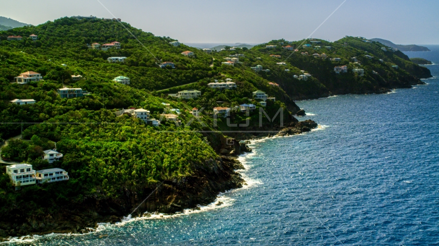 Hillside mansions on an island coast overlooking the ocean, Northside, St Thomas  Aerial Stock Photos | AX102_267.0000000F