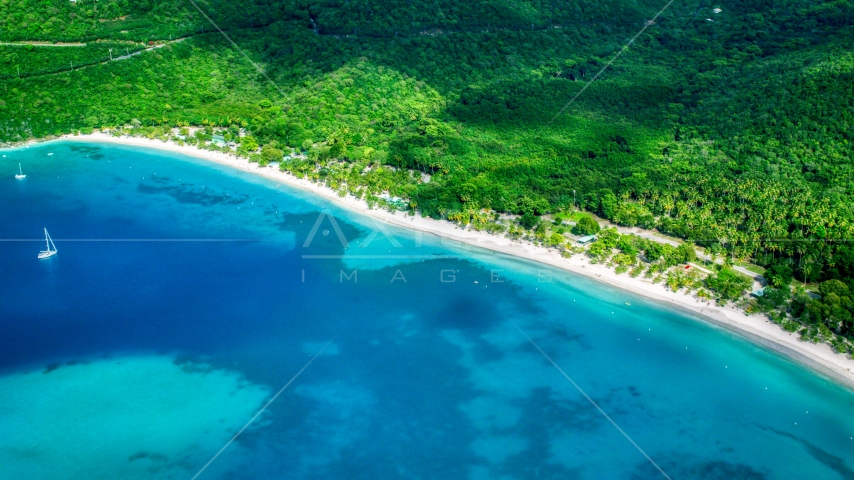 White sand Caribbean island beach and turquoise blue waters, Magens Bay, St Thomas  Aerial Stock Photos | AX102_270.0000000F