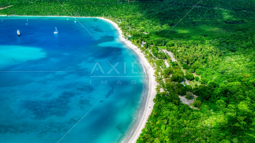 White sand Caribbean island beach and turquoise blue waters, Magens Bay, St Thomas  Aerial Stock Photos | AX102_271.0000000F