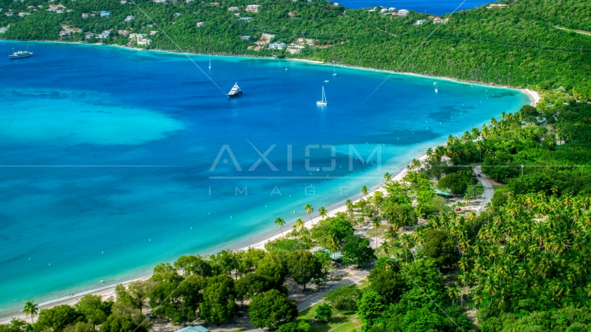White sand Caribbean beach and turquoise blue waters with sailboats, Magens Bay, St Thomas Aerial Stock Photo AX102_272.0000000F | Axiom Images