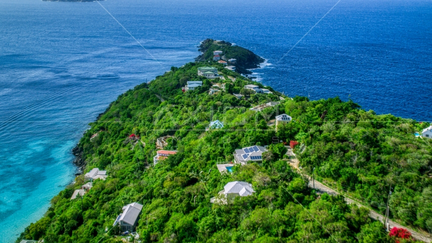 Upscale hilltop homes overlooking Caribbean waters, Magens Bay, St Thomas Aerial Stock Photos | AX102_276.0000000F