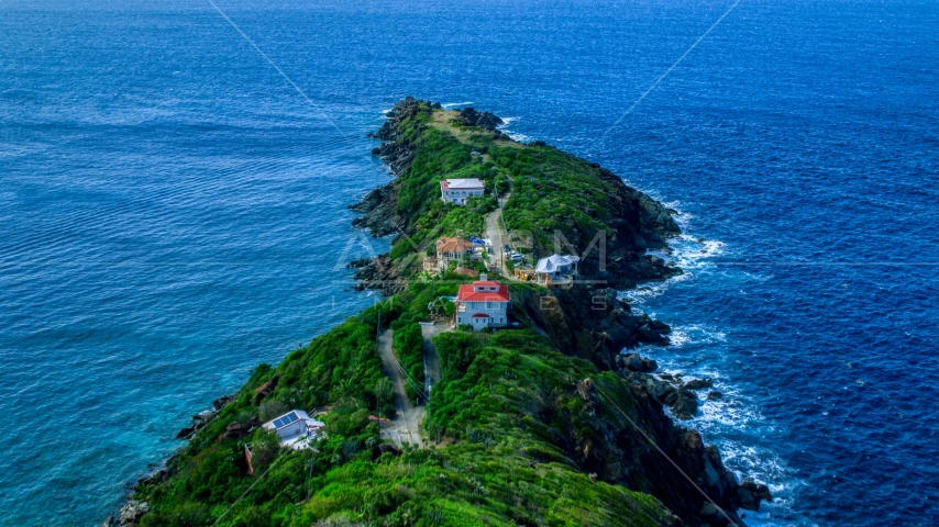 Upscale hilltop homes on a Caribbean island, Magens Bay, St Thomas  Aerial Stock Photos | AX102_277.0000000F