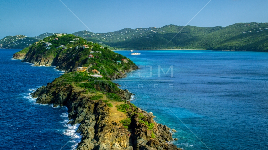 Hillside oceanfront homes by sapphire blue Caribbean waters, Magens Bay, St Thomas  Aerial Stock Photos | AX102_280.0000000F