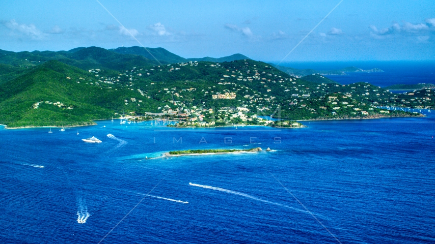 Coastal town on a hillside and blue Caribbean waters, Cruz Bay, St John Aerial Stock Photos | AX103_016.0000000F