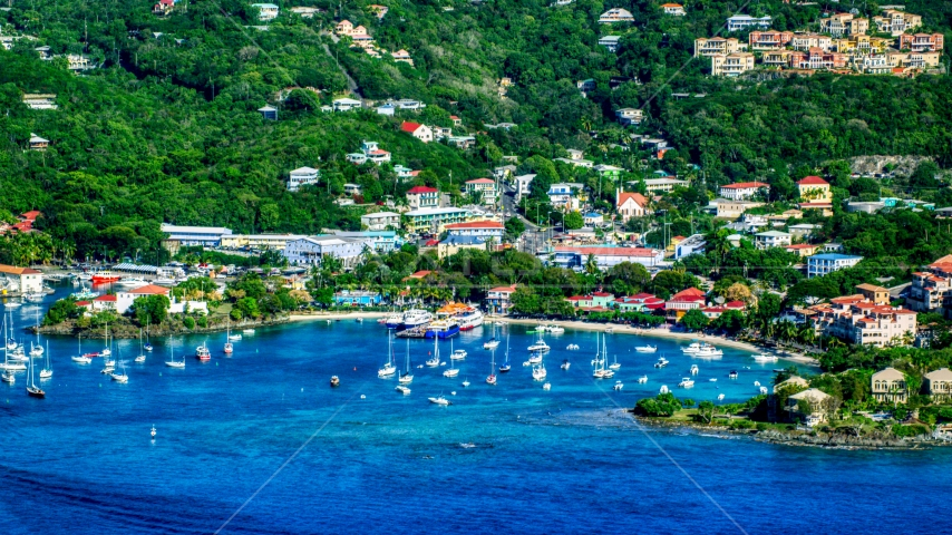 A coastal town and boats in the harbor with Caribbean blue waters, Cruz Bay, St John Aerial Stock Photo AX103_018.0000094F | Axiom Images