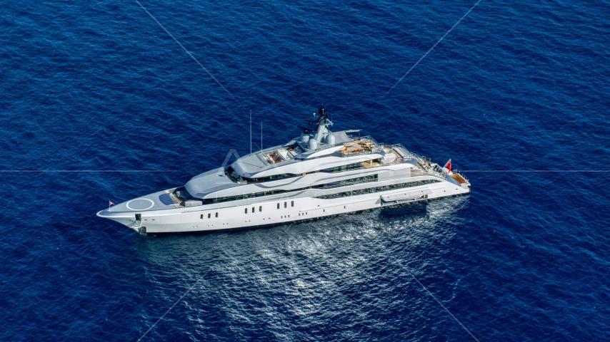 A yacht in sapphire blue waters, Cruz Bay, St John Aerial Stock Photos | AX103_019.0000000F