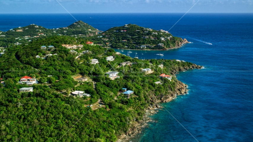 Hillside homes overlooking sapphire blue ocean waters, Cruz Bay, St John Aerial Stock Photos | AX103_020.0000000F