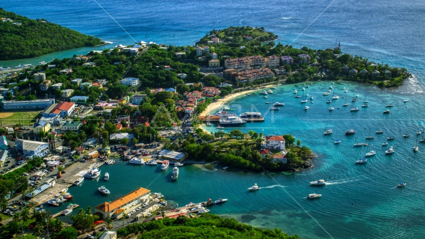 Resort beside the Caribbean blue harbor in Cruz Bay, St John Aerial Stock Photo AX103_023.0000175F | Axiom Images