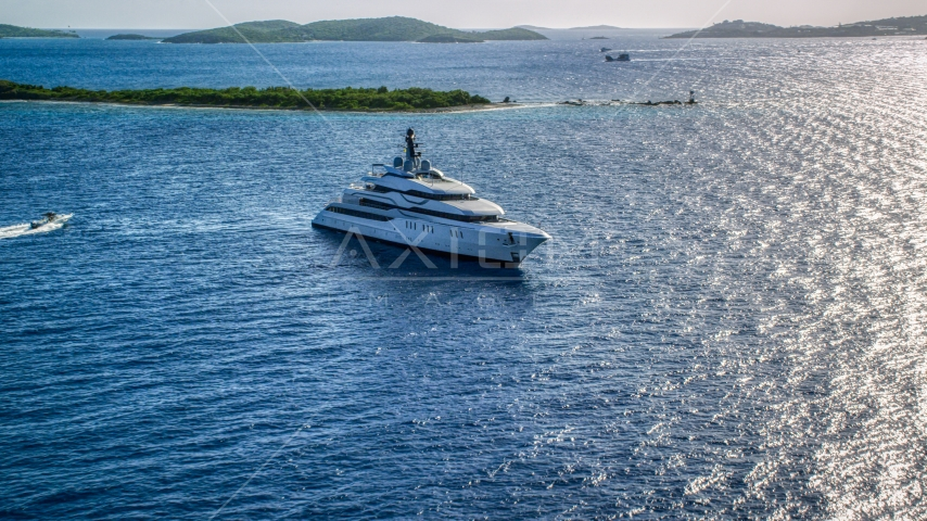 A yacht in sun kissed Caribbean waters among small islands, Cruz Bay, St John Aerial Stock Photos | AX103_025.0000053F