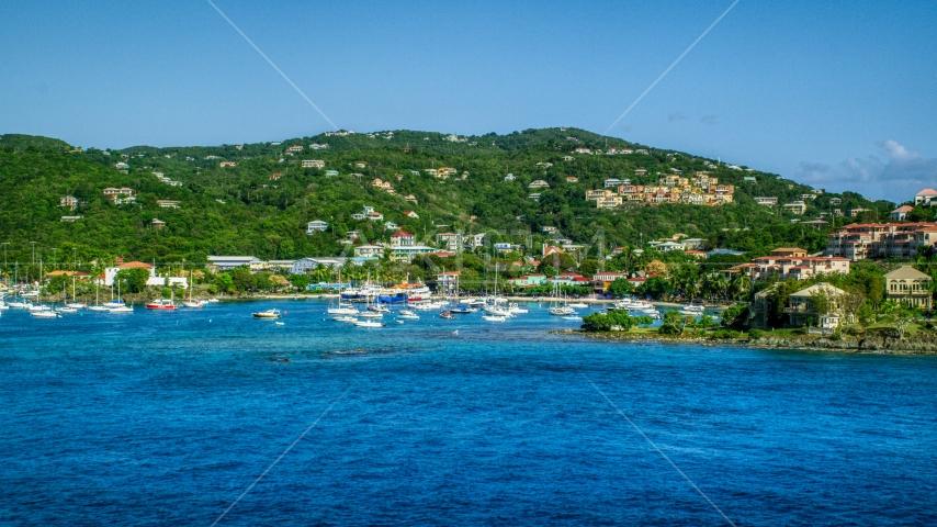 Blue Caribbean waters in the harbor near hillside homes, Cruz Bay, St John Aerial Stock Photos | AX103_029.0000072F