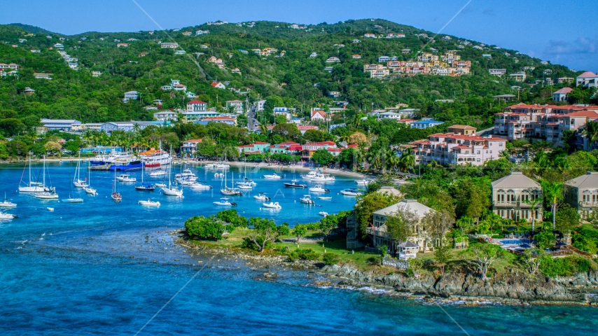 Turquoise blue Caribbean waters in the harbor with boats, Cruz Bay, St John Aerial Stock Photos | AX103_030.0000000F
