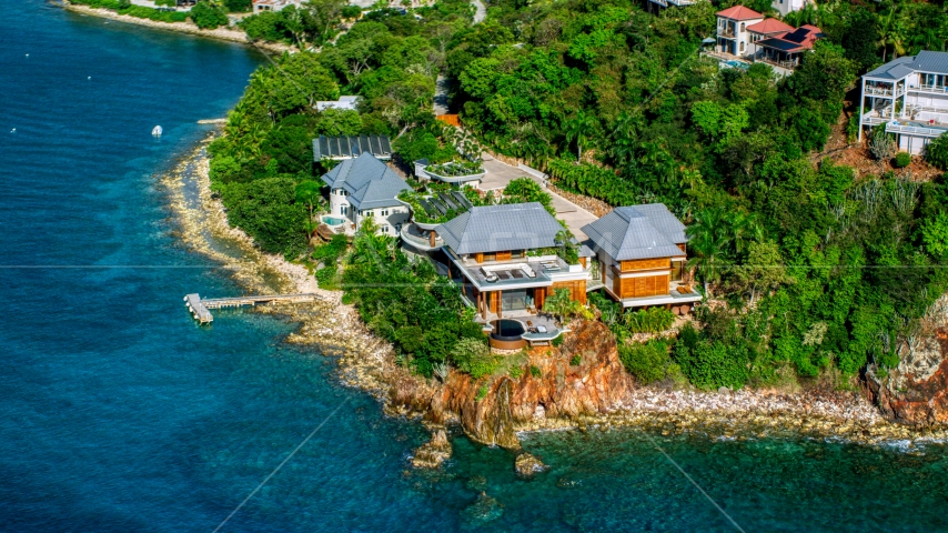 Oceanfront mansion beside turquoise blue Caribbean waters, Cruz Bay, St John Aerial Stock Photos | AX103_034.0000000F