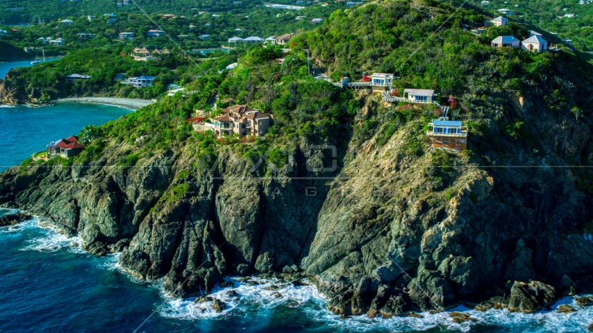 Cliff top mansions above sapphire blue Caribbean waters, Cruz Bay, St John Aerial Stock Photos | AX103_036.0000000F