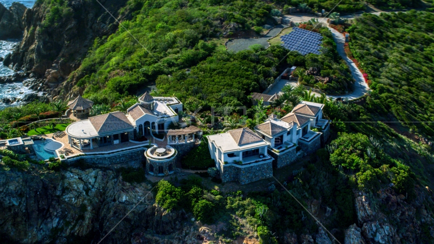 Hilltop mansion with a Caribbean blue ocean view, Cruz Bay, St John Aerial Stock Photos | AX103_039.0000327F