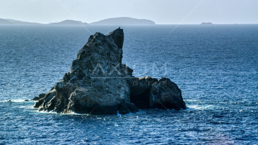 Rock formation in Caribbean blue waters, St Thomas Aerial Stock Photos   AX103_081.0000028F