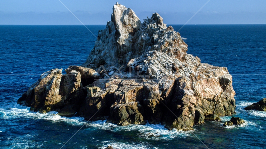 A jagged rock formation in Caribbean blue waters, St Thomas Aerial Stock Photos | AX103_082.0000090F