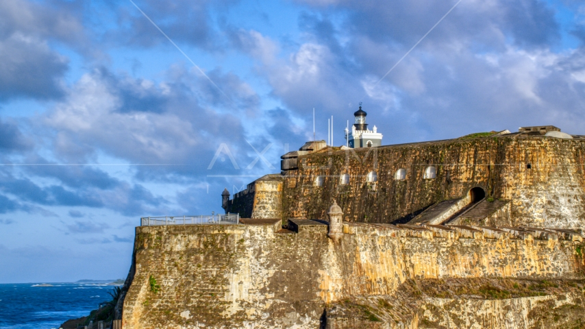 The steep walls and lighthouse of the Fort San Felipe del Morro, Old San Juan, sunset Aerial Stock Photos | AX104_012.0000023F