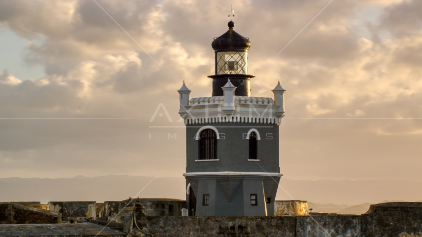 Port San Juan Light atop Fort San Felipe del Morro, Old San Juan, sunset Aerial Stock Photos | AX104_027.0000110F