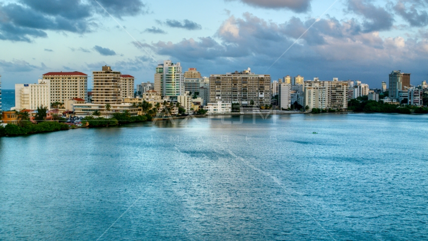 Hotels beside Condado Lagoon, San Juan, Puerto Rico sunset Aerial Stock Photos | AX104_060.0000309F