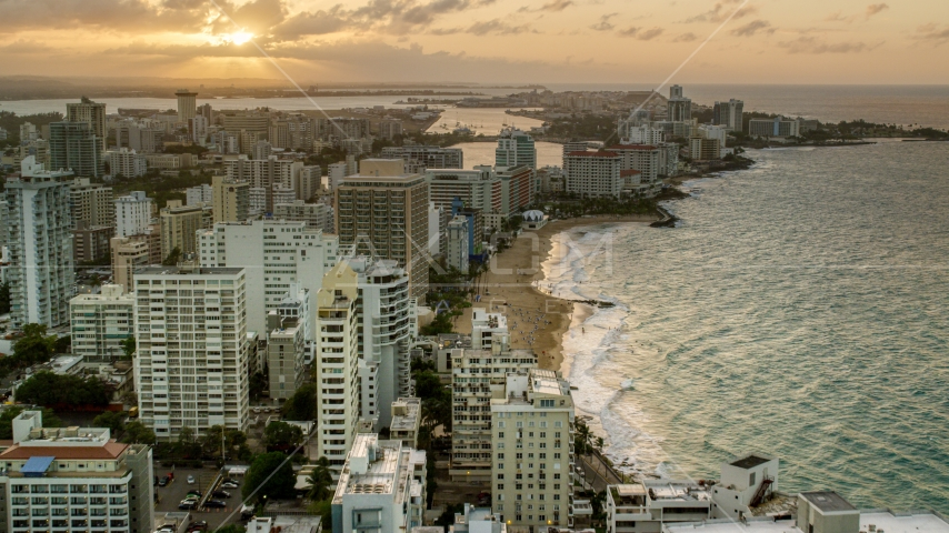 Beachfront hotels and ocean waters, San Juan, Puerto Rico, sunset Aerial Stock Photos | AX104_068.0000000F